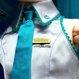 "Also, ""Vocaloid"" is stitched on her blouse!"